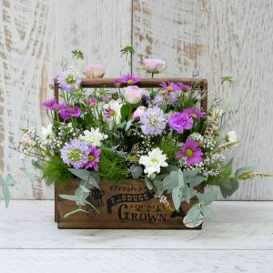 Seasonal flowers in a timber box