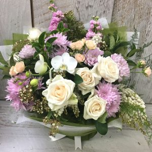 Roses Orchids and mixed blooms